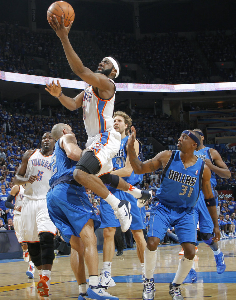 Oklahoma City's James Harden (13) drives to the basket past Jason Kidd (2) of Dallas during game 3 of the Western Conference Finals of the NBA basketball playoffs between the Dallas Mavericks and the Oklahoma City Thunder at the OKC Arena in downtown Oklahoma City, Saturday, May 21, 2011. Photo by Chris Landsberger, The Oklahoman