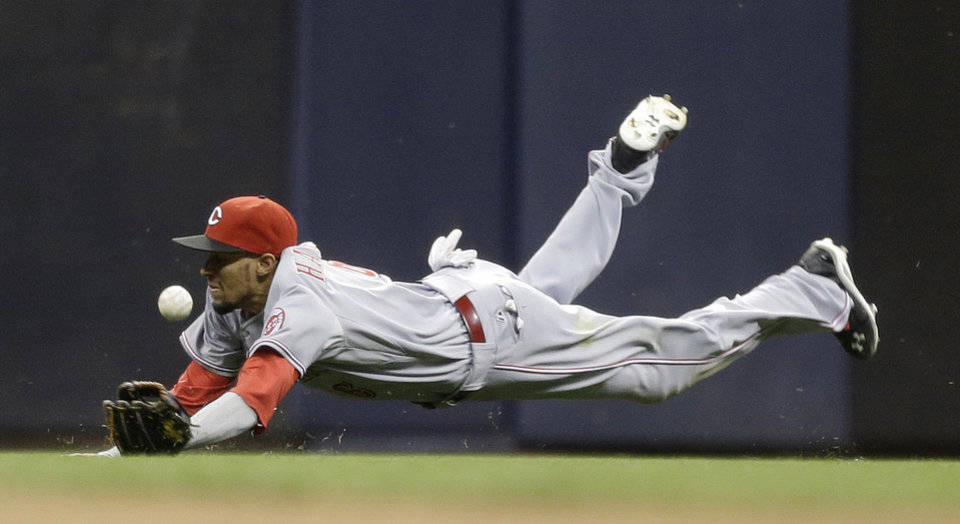 Photo - Cincinnati Reds' Billy Hamilton dives but cannot catch a double hit by Milwaukee Brewers' Scooter Gennett in the eighth inning of a baseball game on Saturday, June 14, 2014, in Milwaukee. (AP Photo/Jeffrey Phelps)