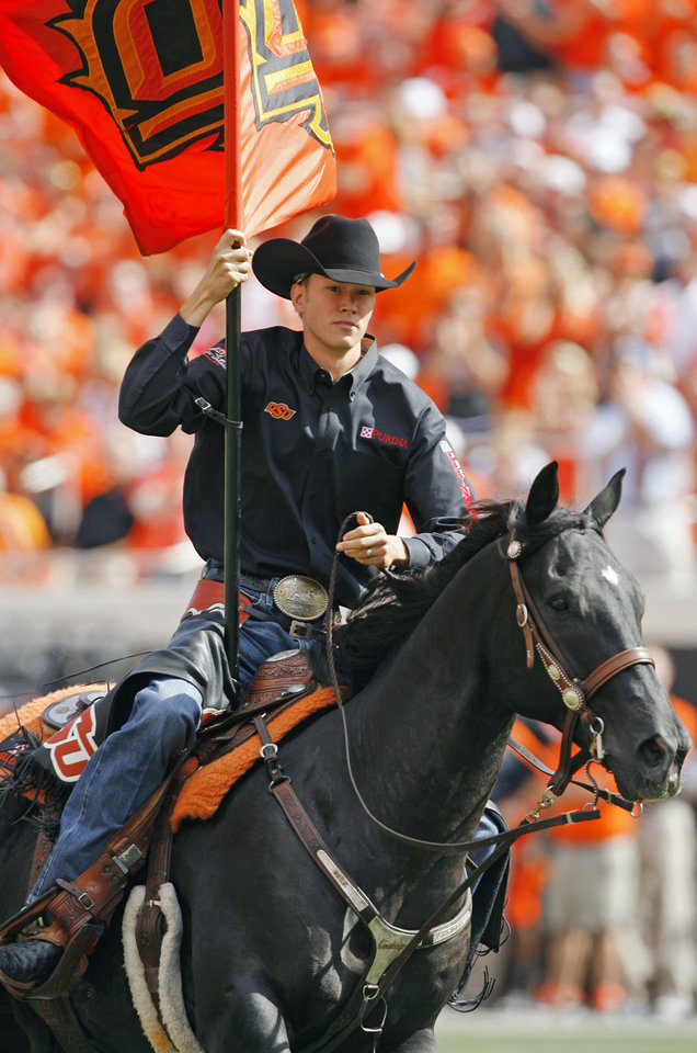 Photo - The Spirit Rider and Bullet were kept busy during a college football game between the Oklahoma State University Cowboys (OSU) and the University of Kansas Jayhawks (KU) at Boone Pickens Stadium in Stillwater, Okla., Saturday, Oct. 8, 2011 Photo by Steve Sisney, The Oklahoman