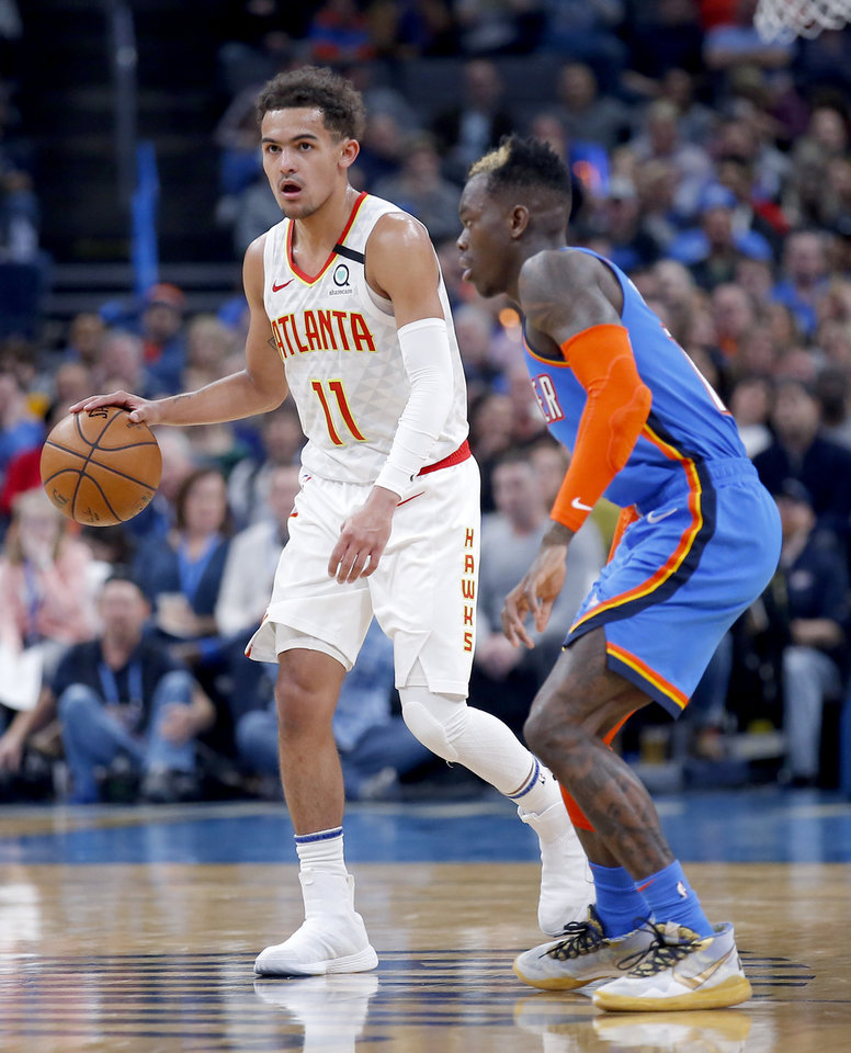 Photo - Atlanta's Trae Young (11) brings the ball up court as Oklahoma City's Dennis Schroder (17) defends during the NBA basketball game between the Oklahoma City Thunder and the Atlanta Hawks at the Chesapeake Energy Arena in Oklahoma City,Friday, Jan. 24, 2020.  [Sarah Phipps/The Oklahoman]