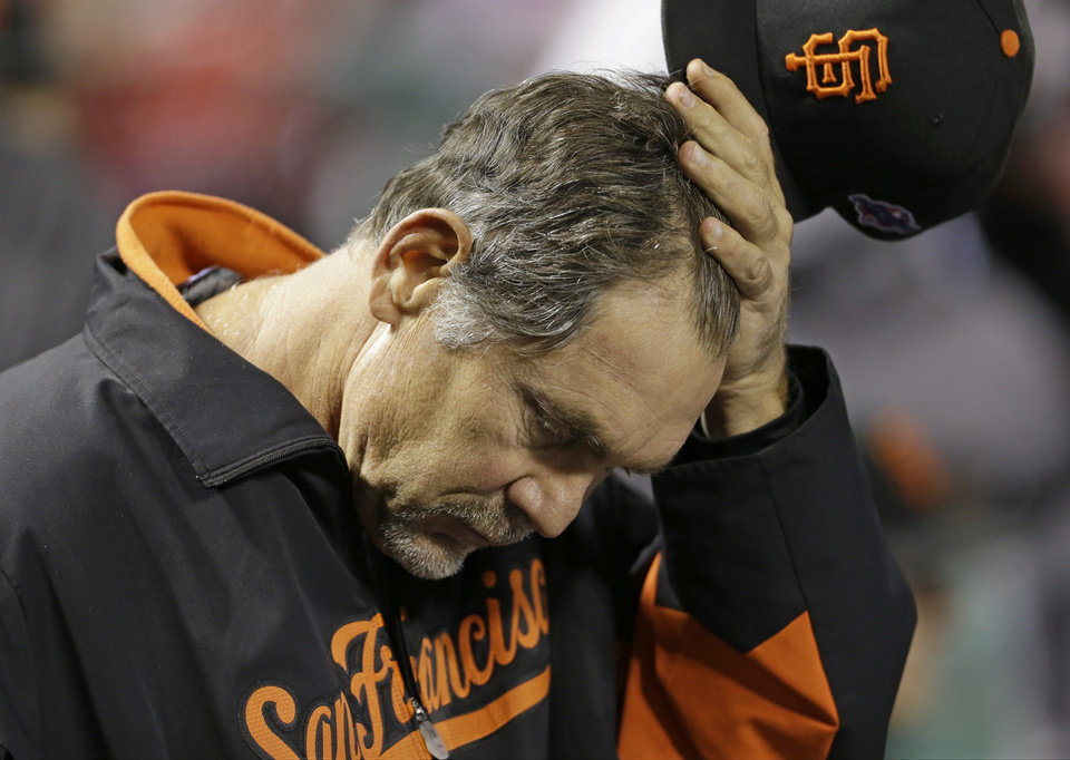 Photo -   San Francisco Giants manager Bruce Bochy scratches his head in the dugout during the seventh inning of Game 4 of baseball's National League championship series against the St. Louis Cardinals Thursday, Oct. 18, 2012, in St. Louis. (AP Photo/Jeff Roberson)
