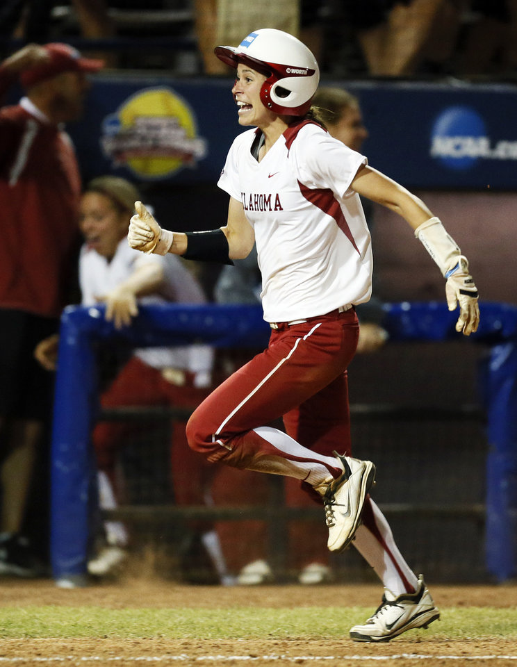 Photo - OU's Brianna Turang (2) heads home after Lauren Chamberlain (44), not pictured, hit the game-winning home run in the twelfth inning during Game 1 of the Women's College World Series NCAA softball championship series between Oklahoma and Tennessee at ASA Hall of Fame Stadium in Oklahoma City, Monday, June 3, 2013. OU won 5-3 in 12 innings. Photo by Nate Billings, The Oklahoman