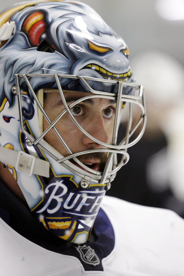 Buffalo Sabres goalie Ryan Miller looks on during an informal NHL hockey workout in Amherst, N.Y., Friday, Jan. 11, 2013. (AP Photo/David Duprey)