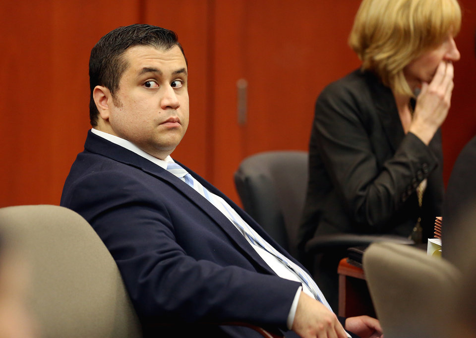 George Zimmerman glances back at the  courtroom during his trial in Seminole circuit court in Sanford, Fla. Wednesday, June 26, 2013. Zimmerman has been charged with second-degree murder for the 2012 shooting death of Trayvon Martin. (AP Photo/Orlando Sentinel, Jacob Langston, Pool)