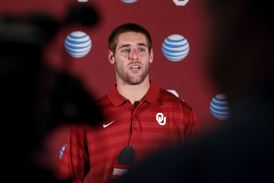 Photo - Quarterback Trevor Knight speaks during the University of Oklahoma Sooners (OU) media luncheon at Gaylord Family-Oklahoma Memorial Stadium in Norman, Okla., on Monday, Aug. 25, 2014. Photo by Steve Sisney, The Oklahoman