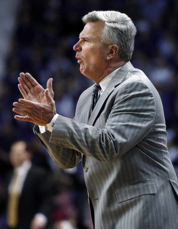 Photo - Kansas State coach Bruce Weber applauds during the first half of an NCAA college basketball game against Baylor in Manhattan, Kan., Saturday, Feb. 16, 2013. (AP Photo/Orlin Wagner)
