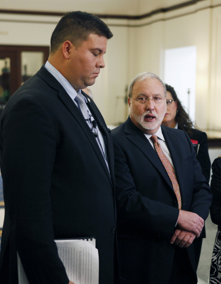 Sen. Ralph Shortey, left, and Doug Friesen, attorney for convicted murderer Jerome Ersland, hold a news conference Monday at the Oklahoma Judicial Center.  <strong>PAUL HELLSTERN - Oklahoman</strong>