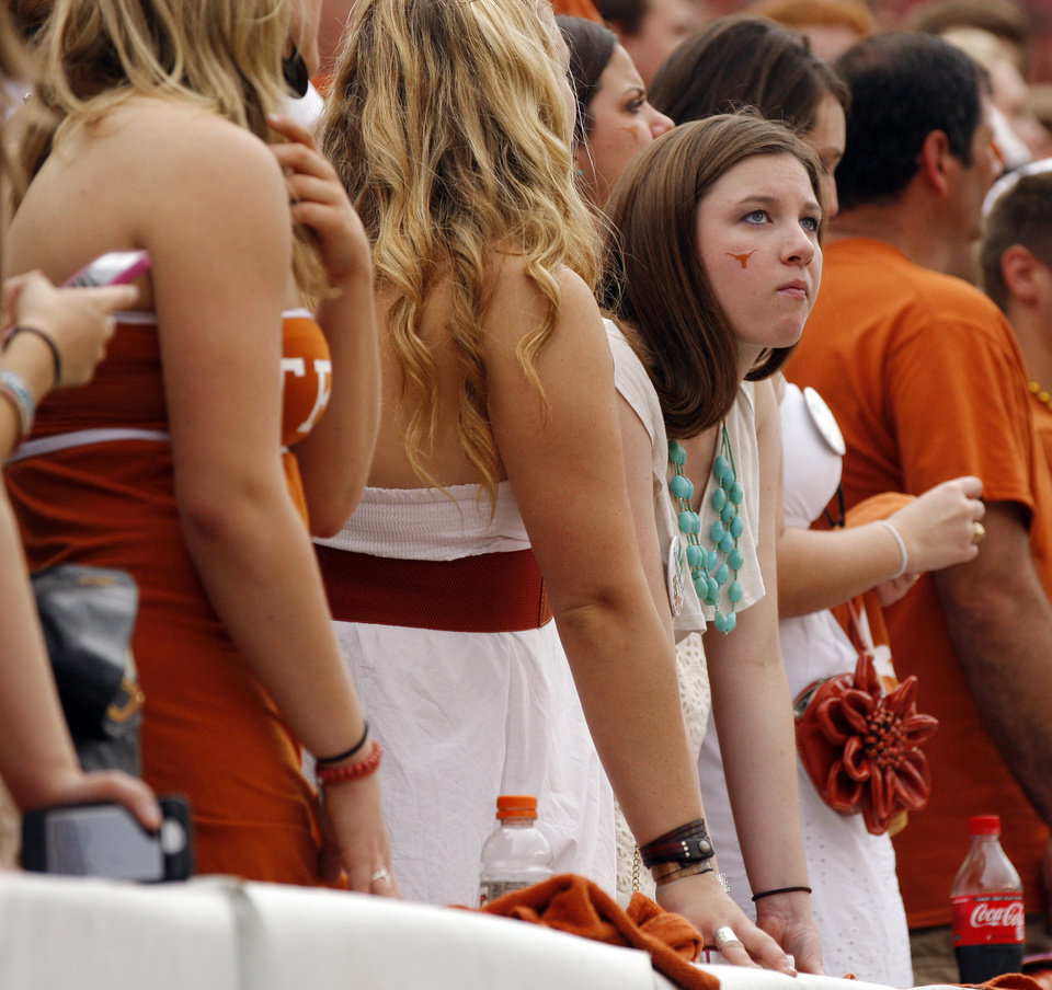 Photo - A Texas fan looks stunned after OU scored a safety in the second quarter during the Red River Rivalry college football game between the University of Oklahoma (OU) and the University of Texas (UT) at the Cotton Bowl in Dallas, Saturday, Oct. 13, 2012. Photo by Nate Billings, The Oklahoman