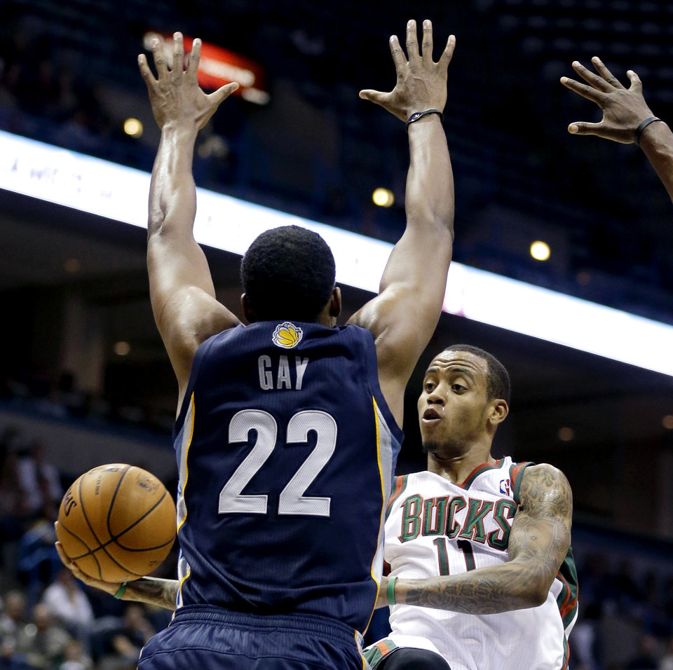 Milwaukee Bucks' Monta Ellis (11) passes around Memphis Grizzlies' Rudy Gay during the second half of an NBA basketball game, Wednesday, Nov. 7, 2012, in Milwaukee. (AP Photo/Jeffrey Phelps)