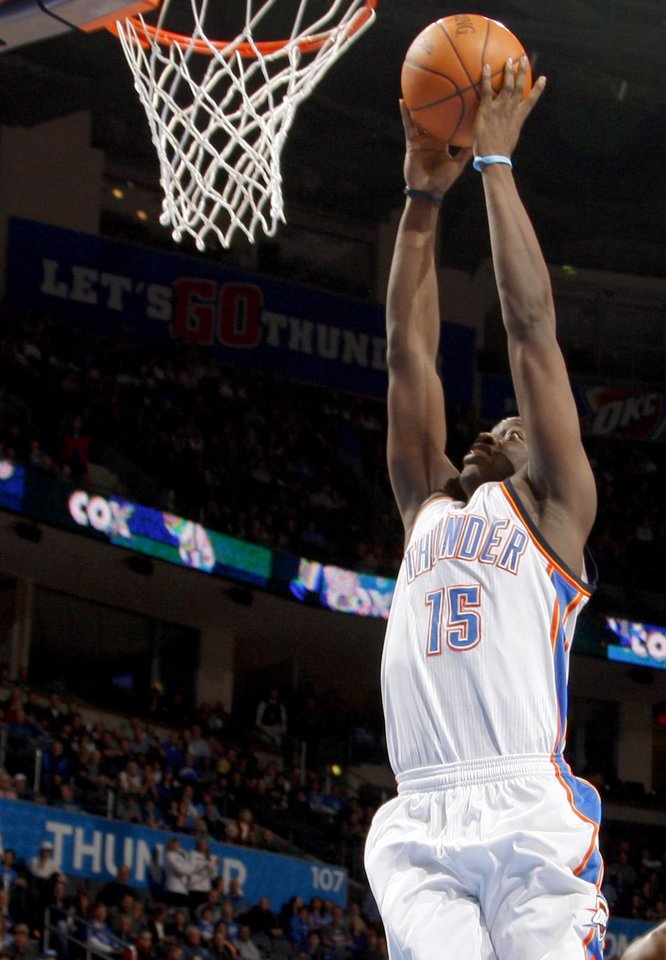 Photo - Oklahoma City's Reggie Jackson (15) goes up for a dunk during an NBA game between the Oklahoma City Thunder and the Utah Jazz at Chesapeake Energy Arena in Oklahoma CIty, Tuesday, Feb. 14, 2012. Photo by Bryan Terry, The Oklahoman