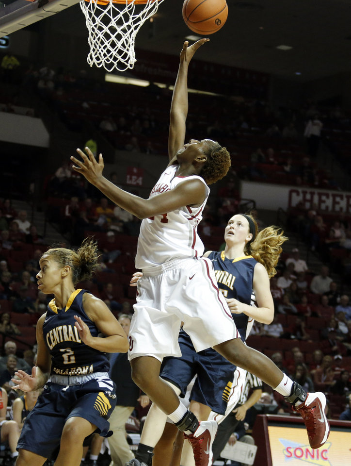 Photo - Oklahoma's Sharane Campbell shoots over UCO's Rachel New during the college women's basketball game between the University of Oklahoma and University of Central Oklahoma at the Lloyd Noble Center in Norman, Okla., Tuesday, Nov. 5, 2013. Photo by Sarah Phipps, The Oklahoman