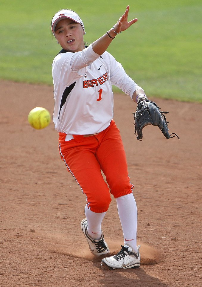 Oregon State's Ya Garcia throws to first during an NCAA softball regional between the University of Oklahoma and  Oregon State in Norman, Okla., Sunday, May 20, 2012. Photo by Sarah Phipps, The Oklahoman