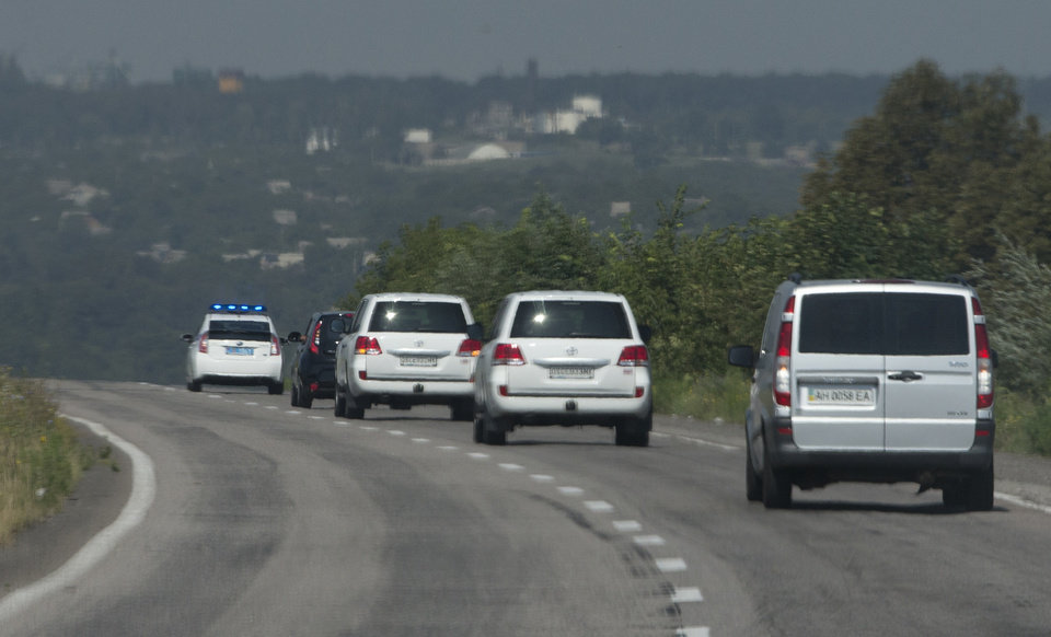 Photo - Convoy of the OSCE mission in Ukraine travel outside the city of Donetsk, eastern Ukraine Wednesday, July 30, 2014 as they try to estimate security conditions. (AP Photo/Dmitry Lovetsky)