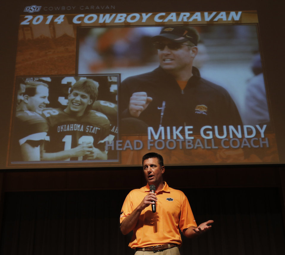 Photo - Mike Gundy, Oklahoma State head football coach, addresses the crowd during the OSU Cowboy Caravan at the National Cowboy and Western Heritage Museum Tuesday, August 5, 2014. Photo by Doug Hoke, The Oklahoman
