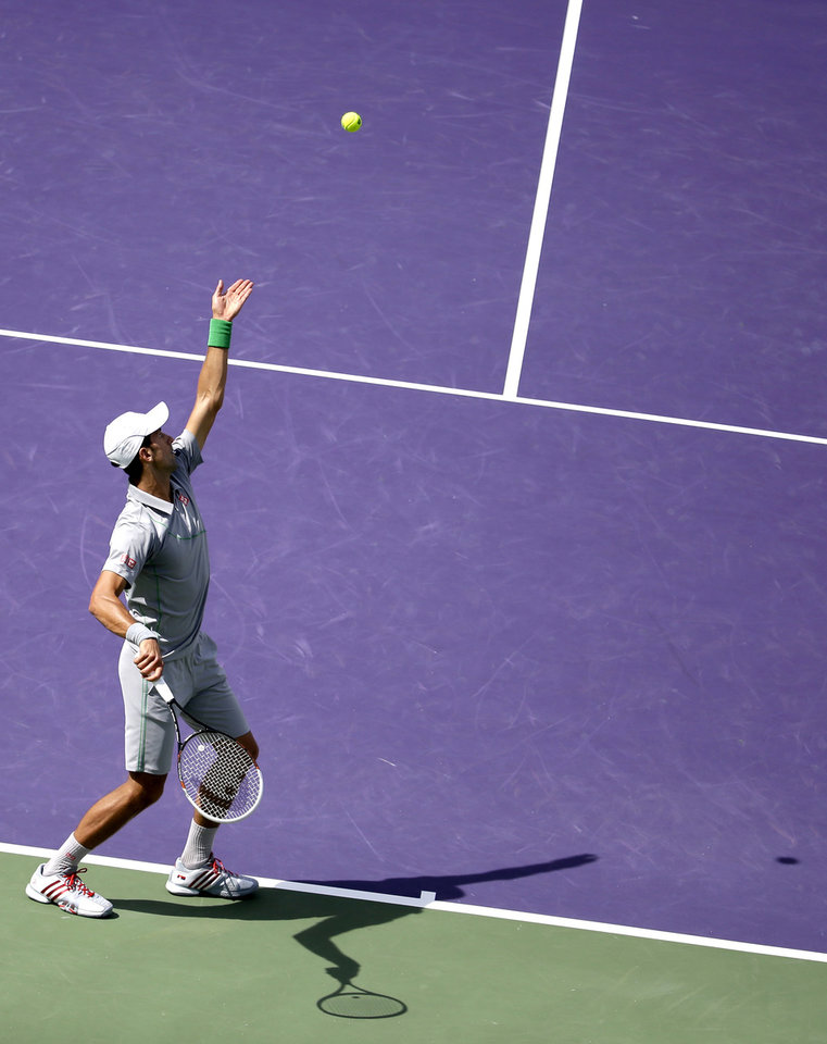 Photo - Novak Djokovic, of Serbia, serves to Rafael Nadal, of Spain, during the men's final match at the Sony Open Tennis tournament on Sunday, March 30, 2014, in Key Biscayne, Fla. (AP Photo/Lynne Sladky)