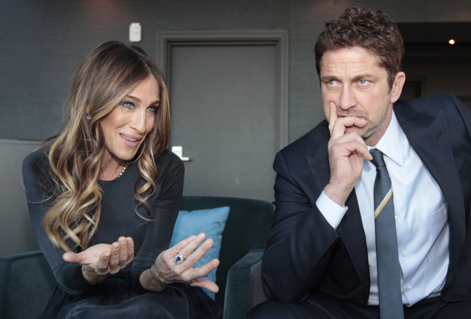 U.S. actress Sarah Jessica Parker, left, and Scottish actor Gerard Butler are interviewed by the Associated Press, ahead of hosting the Nobel Peace Prize Concert in Oslo, Norway, Tuesday Dec. 11, 2012. The Nobel Peace Prize Committee awarded the prize to the European Union for its efforts to promote peace and democracy in Europe, despite being in the midst of its biggest crisis since the bloc was created in the 1950\'s. (AP Photo/Yves Logghe)