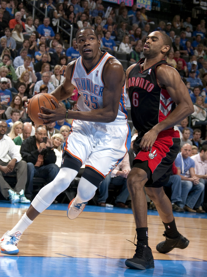Oklahoma City\'s Kevin Durant (35) drives to the basket as Toronto\'s Alan Anderson (6) defends during the NBA basketball game between the Oklahoma City Thunder and the Toronto Raptors at Chesapeake Energy Arena in Oklahoma City, Sunday, April 8, 2012. Photo by Sarah Phipps, The Oklahoman.
