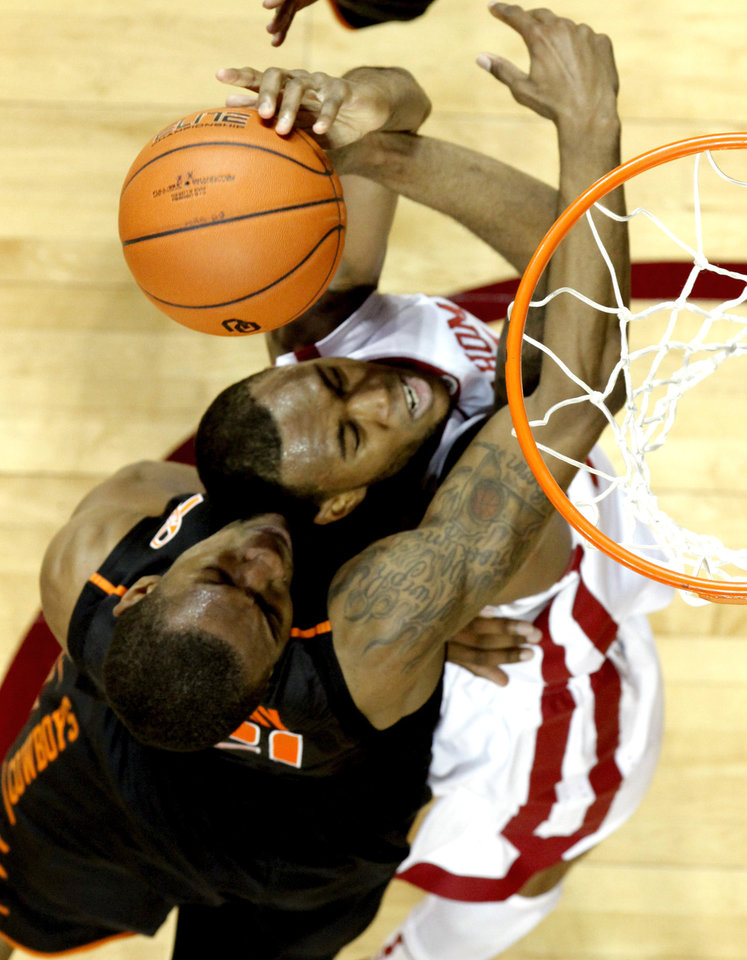 Photo - Amath M'Baye (22) and Cowboy's Le'Bryan Nash (2) go for a rebound as the University of Oklahoma Sooners (OU) defeat the Oklahoma State Cowboys (OSU) 77-68  in NCAA, men's college basketball at The Lloyd Noble Center on Saturday, Jan. 12, 2013  in Norman, Okla. Photo by Steve Sisney, The Oklahoman