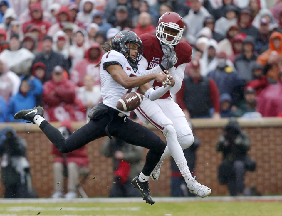Photo - Oklahoma State's Ramon Richards (7) breaks up a pass intended for Oklahoma's Jeffery Mead (15) during the Bedlam college football game between the Oklahoma Sooners (OU) and the Oklahoma State Cowboys (OSU) at Gaylord Family - Oklahoma Memorial Stadium in Norman, Okla., Saturday, Dec. 3, 2016. OU won 38-20. Photo by Sarah Phipps, The Oklahoman