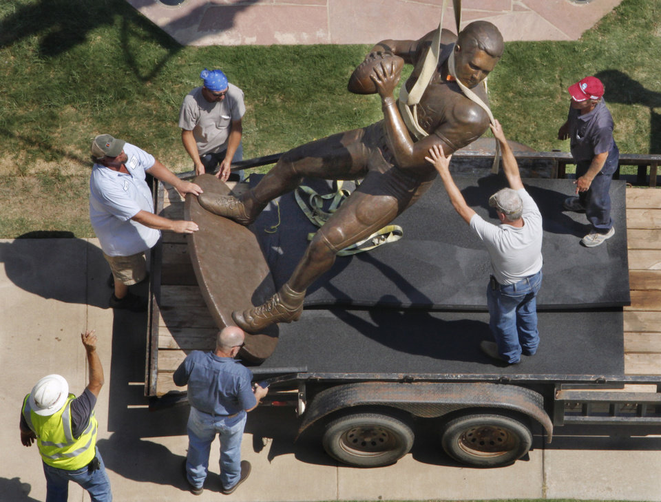 Workers install a statue of Sam Bradford in Heisman Park at the University of Oklahoma (OU) on Wednesday, August 31, 2011, in Norman, Okla.   Photo by Steve Sisney, The Oklahoman