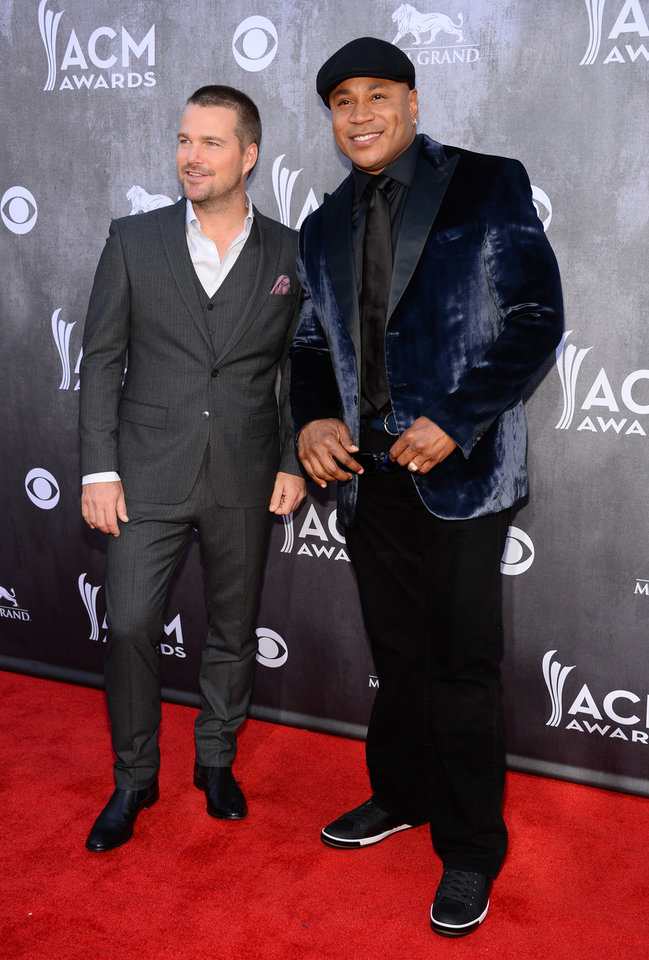 Photo - Chris O'Donnell, left, and LL Cool J arrive at the 49th annual Academy of Country Music Awards at the MGM Grand Garden Arena on Sunday, April 6, 2014, in Las Vegas. (Photo by Al Powers/Powers Imagery/Invision/AP)