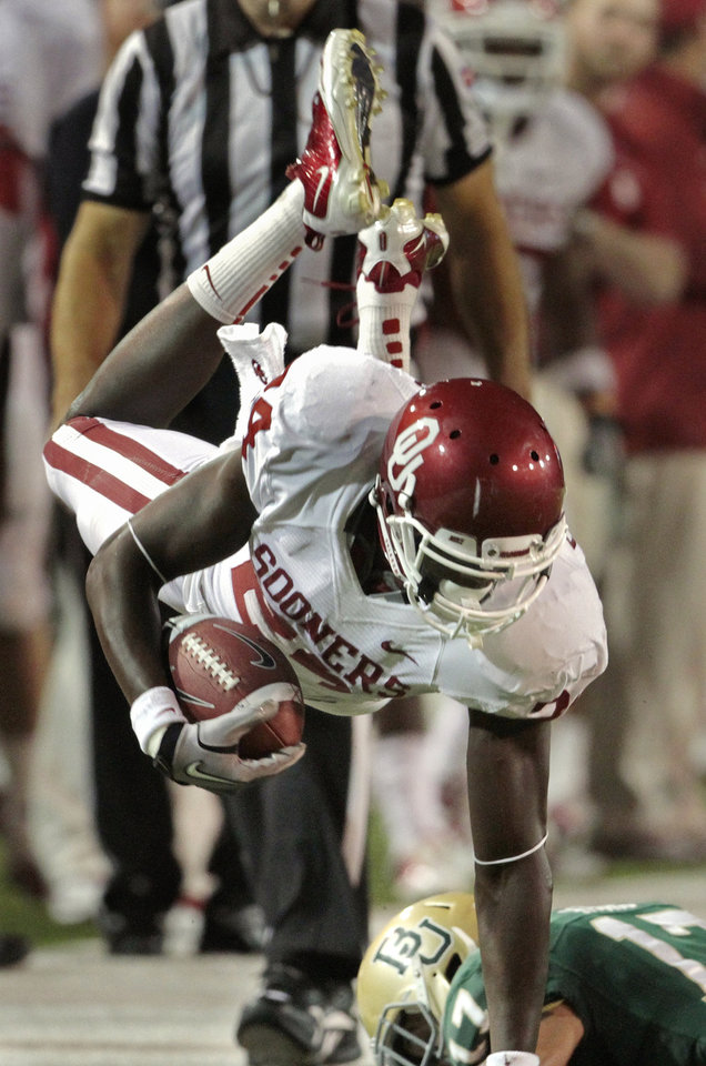 Photo - Oklahoma's Dejuan Miller (24) is pushed out of bounds after a catch during the second half of the college football game in which the University of Oklahoma Sooners (OU) was defeated 45-38 by the Baylor Bears (BU) at Floyd Casey Stadium on Saturday, Nov. 19, 2011, in Waco, Texas.   Photo by Steve Sisney, The Oklahoman ORG XMIT: KOD