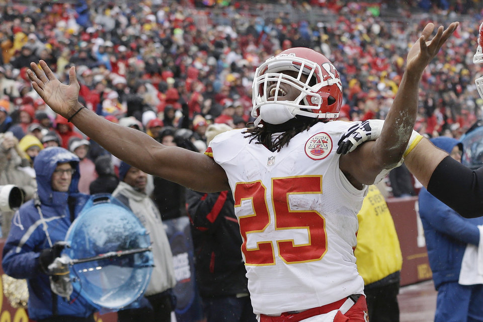 Kansas City Chiefs running back Jamaal Charles celebrates his touchdown during the first half of an NFL football game against the Washington Redskins in Landover, Md., Sunday, Dec. 8, 2013. (AP Photo/Pablo Martinez Monsivais)