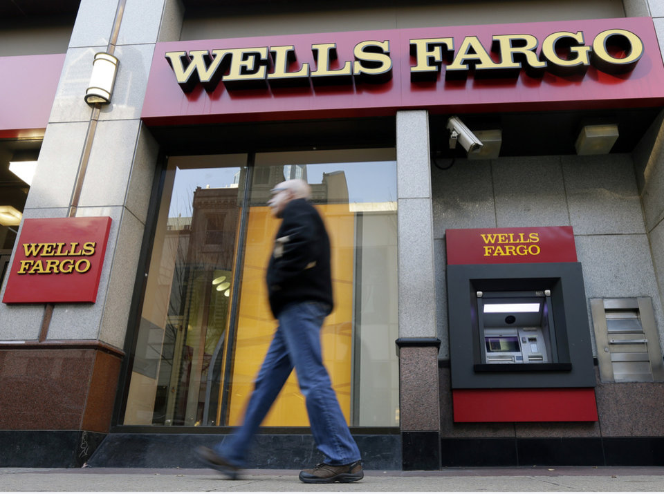 In this Wednesday, Dec. 19, 2012 photo, a man walks past a Wells Fargo location in Philadelphia. U.S. banks are closing the year with the strongest profits since 2006 and fewer failures than at any time since the financial crisis struck in 2008. They're helping support an economy slowed by high unemployment, flat pay, sluggish manufacturing and anxious consumers. (AP Photo/Matt Rourke)