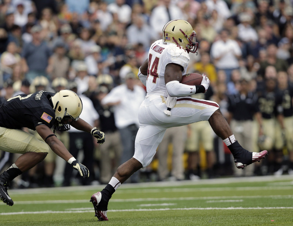Photo -   Boston College running back Andre Williams (44) breaks away from Army defensive back Chris Carnegie (3) for a 99-yard touchdown run during the first half of an NCAA college football game Saturday, Oct. 6, 2012, in West Point, N.Y. (AP Photo/Mike Groll)