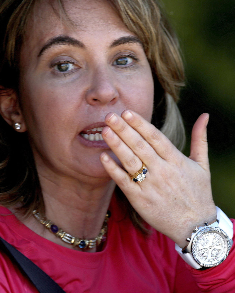 Photo - Former Arizona Rep. Gabrielle Giffords, D-Tucson, blows kisses to the media, waves, and says