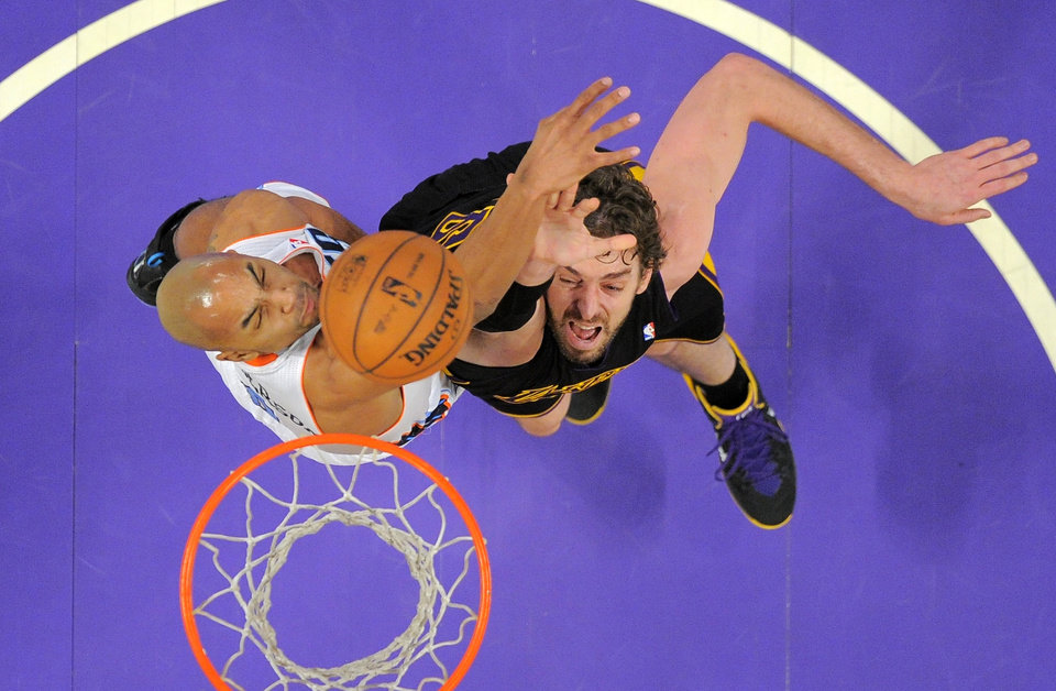 Photo - Charlotte Bobcats guard Gerald Henderson, left, defendsLos Angeles Lakers center Pau Gasol during the first half of an NBA basketball game, Friday, Jan. 31, 2014, in Los Angeles. (AP Photo/Mark J. Terrill)
