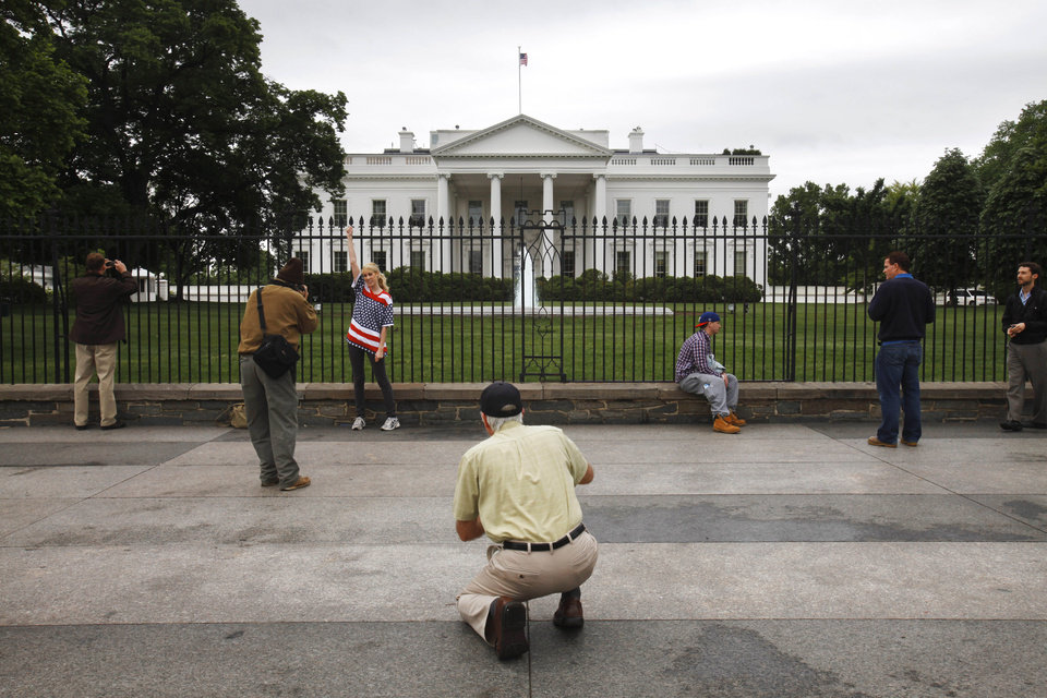 Photo - Visitors gather and take pictures in front of the White House in Washington, on Monday, May 2, 2011, the morning after it was announced that Osama bin Laden had been killed. (AP Photo/Jacquelyn Martin) ORG XMIT: DCJM201