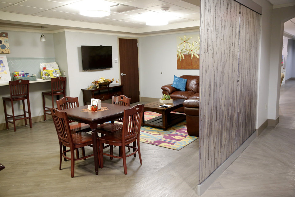 Photo -  The dining room is pictured at the Ronald McDonald House at Garrison Tower on Thursday in Oklahoma City. [Photo by Sarah Phipps, The Oklahoman]