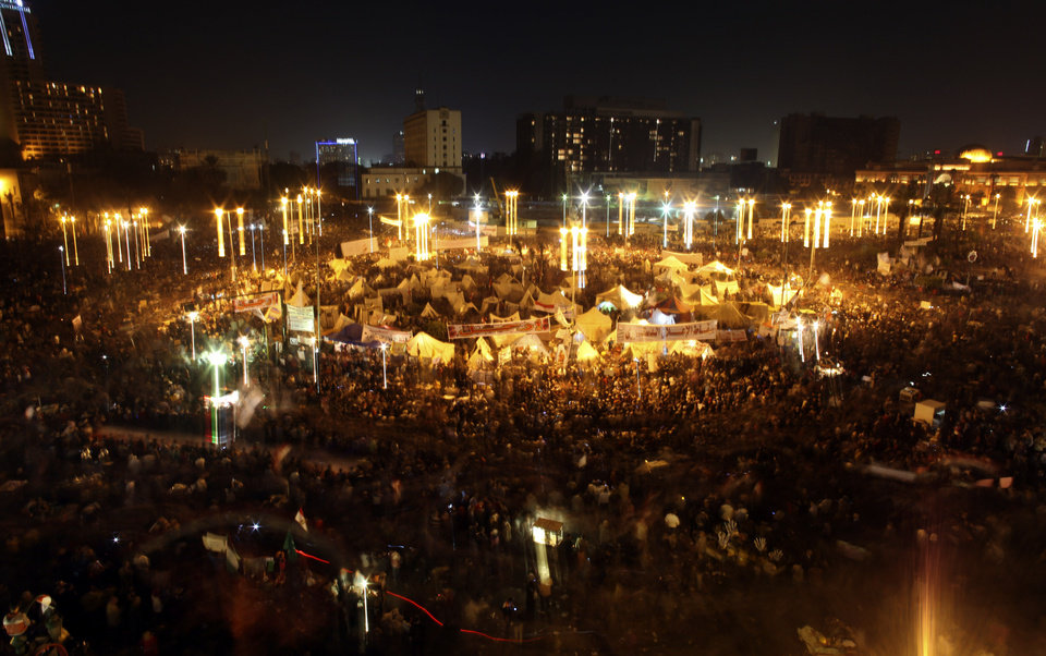 Egyptian protesters attend an opposition rally in Tahrir Square in Cairo, Egypt, Tuesday, Nov. 27, 2012. More than 100,000 people flocked to Cairo's central Tahrir square on Tuesday, chanting against Egypt's Islamist president in a powerful show of strength by the opposition demanding Mohammed Morsi revoke edicts granting himself near autocratic powers.(AP Photo/Khalil Hamra)