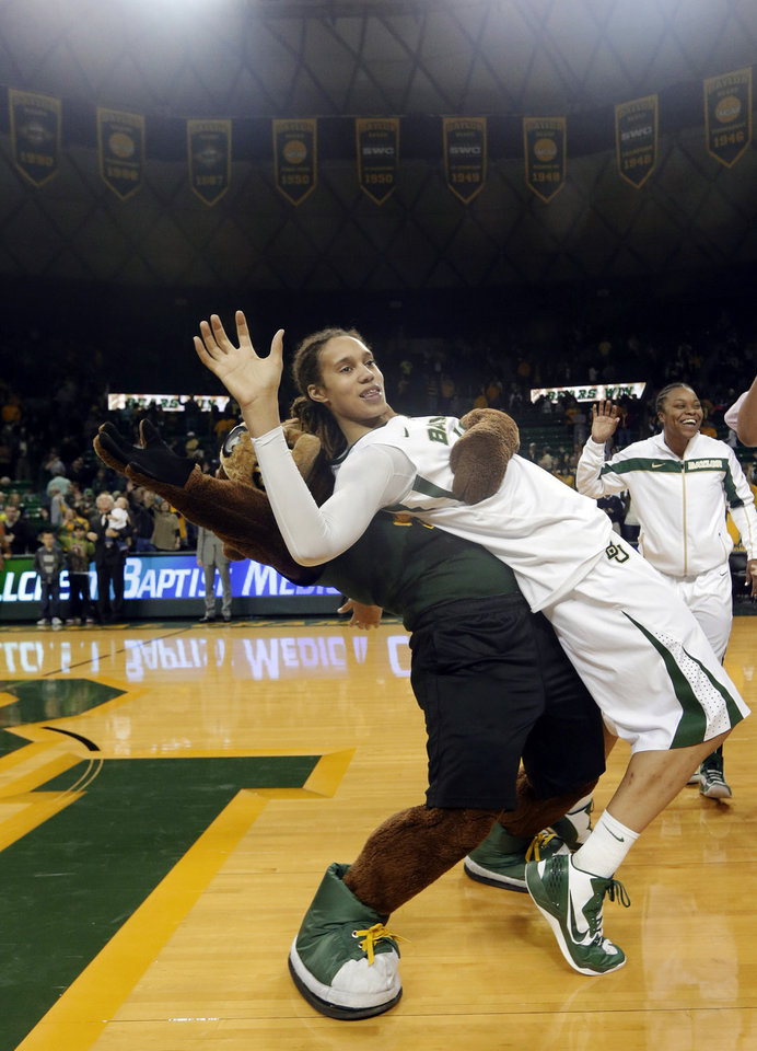 Photo - Baylor's Brittney Griner (42) celebrates with the team mascot after their 82-65 win over Oklahoma in an NCAA college basketball game, Saturday, Jan. 26, 2013, in Waco Texas. Griner broke the NCAA women's career record for blocks. (AP Photo/LM Otero) ORG XMIT: TXMO116