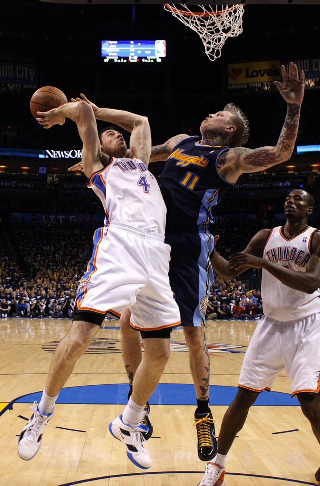 Photo - Oklahoma City's Nick Collison (4) shoots as Denver's Chris Andersen (11) defends him during the NBA basketball game between the Denver Nuggets and the Oklahoma City Thunder in the first round of the NBA playoffs at the Oklahoma City Arena, Wednesday, April 27, 2011. Photo by Sarah Phipps, The Oklahoman