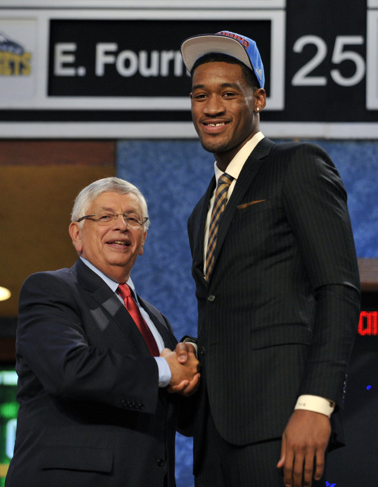 Photo - NBA Commissioner David Stern, left, poses with the No. 28 overall draft pick Perry Jones III, of Baylor, who was selected by the Oklahoma City Thunder in the NBA basketball draft, Thursday, June, 28, 2012, in Newark, N.J. (AP Photo/Bill Kostroun)  ORG XMIT: NJME136