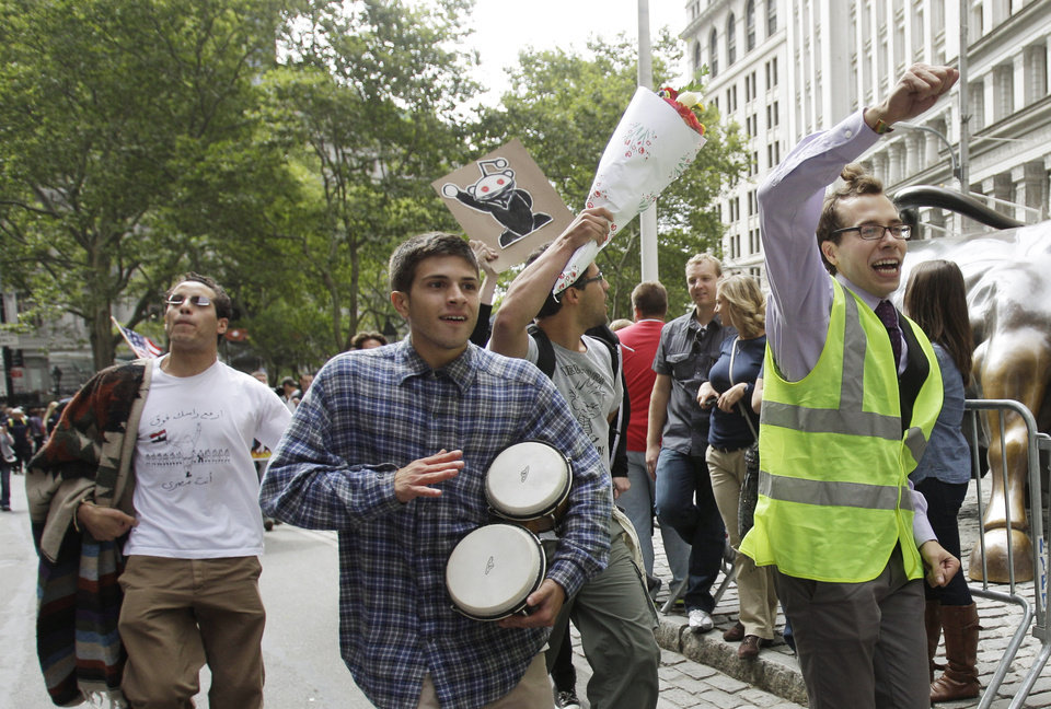 Photo -   FILE - In this Sept. 17, 2011 file photo, a man beats a pair of bongo drums as demonstrators affiliated with the Occupy Wall Street movement gather to call for the occupation of Wall Street in New York. Monday, Oct. 17, 2012 marks the one-year anniversary of the Occupy Wall Street movement. (AP Photo/Frank Franklin II, File)