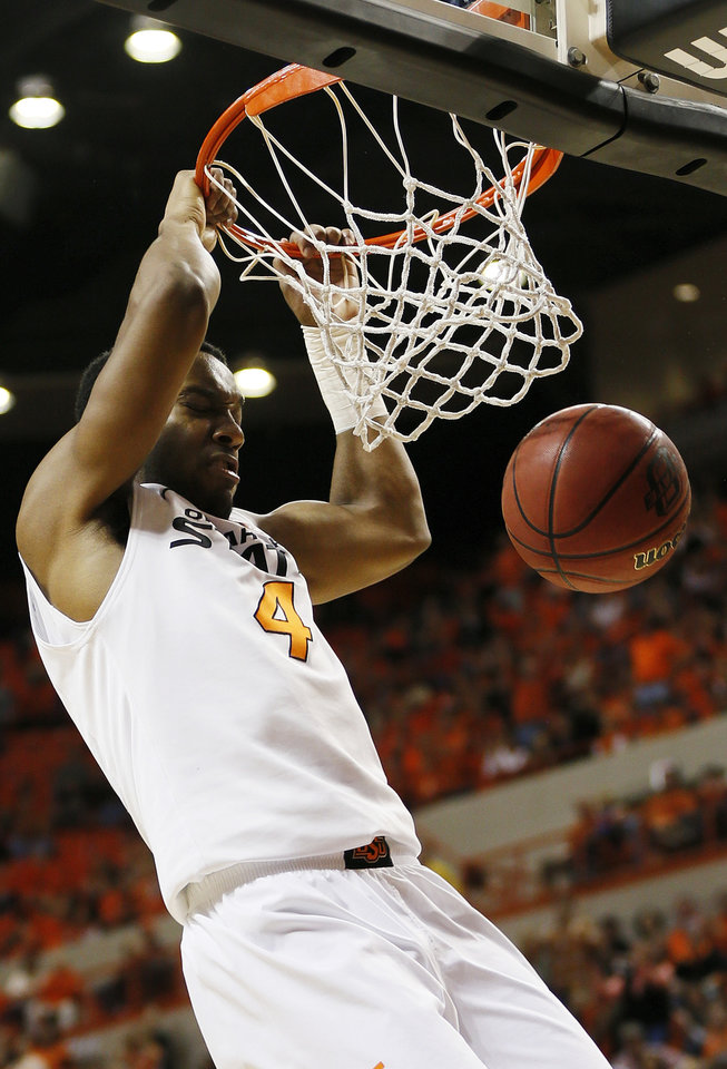Oklahoma State's Brian Williams (4) dunks the ball during a men's college basketball game between Oklahoma State University (OSU) and the University of Texas at Gallagher-Iba Arena in Stillwater, Okla., Saturday, March 2, 2013. OSU won, 78-65. Photo by Nate Billings, The Oklahoman