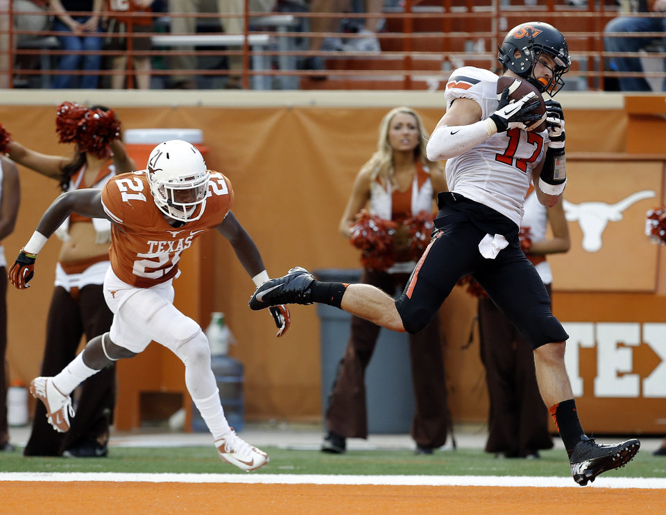 Oklahoma State's Charlie Moore (17) catches a touchdown pass in front of UT's Duke Thomas (21) in the third quarter during a college football game between the Oklahoma State University Cowboys (OSU) and the University of Texas Longhorns (UT) at Darrell K Royal - Texas Memorial Stadium in Austin, Texas, Saturday, Nov. 16, 2013. Photo by Sarah Phipps The Oklahoman