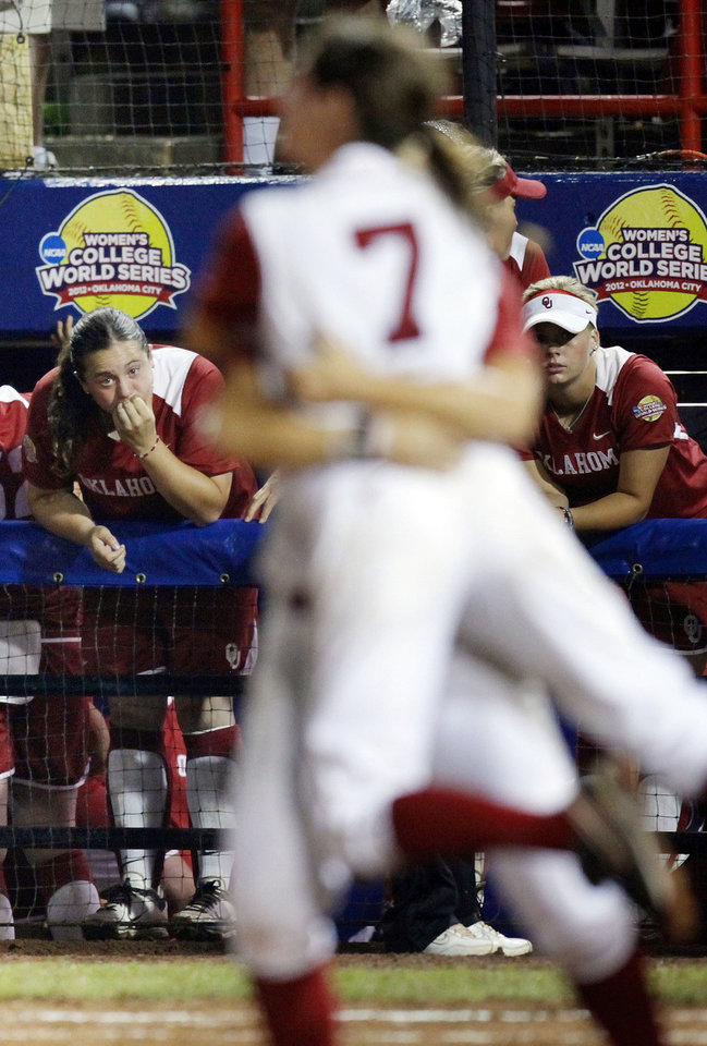Oklahoma's Brittany Williams (23), left, and Erica Sampson (63), right, watch the Alabama Crimson Tide celebrate after winning Game 3 of the Women's College World Series softball championship between OU and Alabama at ASA Hall of Fame Stadium in Oklahoma City, Wednesday, June 6, 2012. Alabama won the game, 5-4, and the championship. Photo by Nate Billings, The Oklahoman