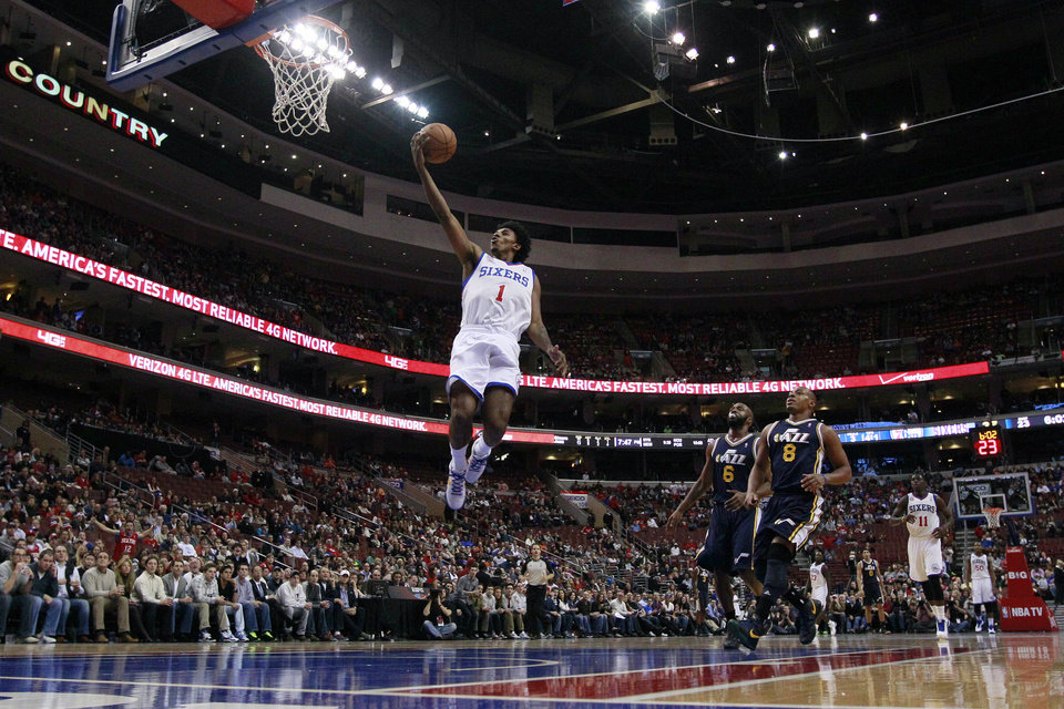 Philadelphia 76ers\' Nick Young (1) goes up for a shot as Utah Jazz\'s Jamaal Tinsley (6) and Randy Foye (8) look on during the first half of an NBA basketball game on Friday, Nov. 16, 2012, in Philadelphia. (AP Photo/Matt Slocum)