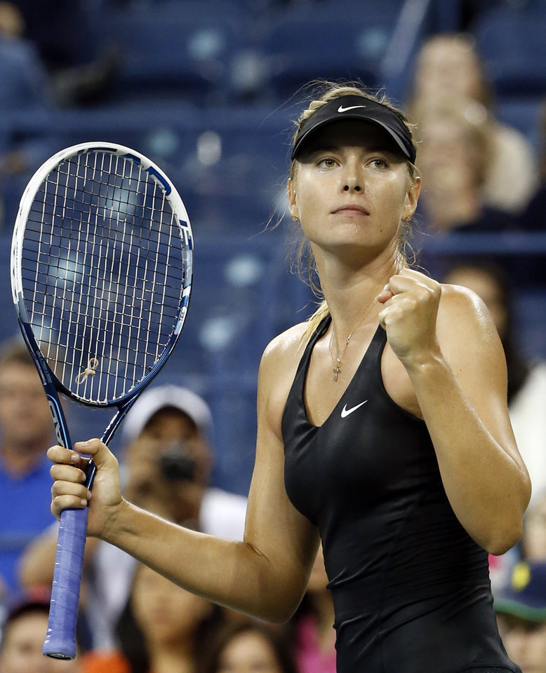 Photo - Maria Sharapova, of Russia, reacts after defeating Sabine Lisicki, of Germany, 6-2, 6-4 during the third round of the U.S. Open tennis tournament Friday, Aug. 29, 2014, in New York. (AP Photo/Jason DeCrow)
