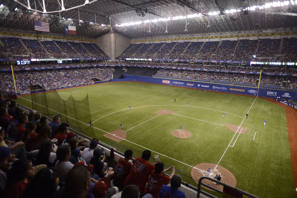 The San Diego Padres and the Texas Rangers play an exhibition baseball game, Saturday, March 30, 2013, at the Alamodome in San Antonio. Texas won 5-2. (AP Photo/Darren Abate)