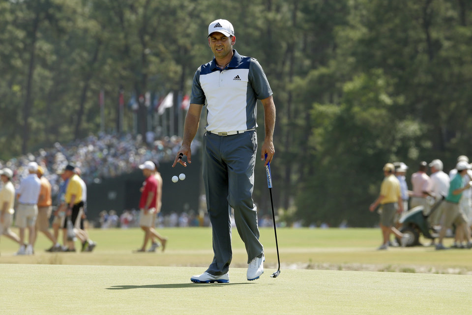 Photo - Sergio Garcia, of Spain, lines up his putt on the 18th hole during a practice round for the U.S. Open golf tournament in Pinehurst, N.C., Wednesday, June 11, 2014. The tournament starts Thursday. (AP Photo/Charlie Riedel)