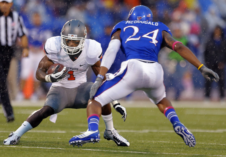 Oklahoma State's Joseph Randle (1) gets by Kansas' Bradley McDougald (24) during the college football game between Oklahoma State University (OSU) and the University of Kansas (KU) at Memorial Stadium in Lawrence, Kan., Saturday, Oct. 13, 2012. Photo by Sarah Phipps, The Oklahoman