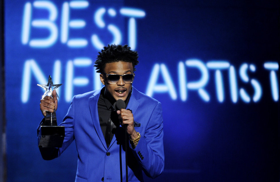 Photo - August Alsina accepts the award for best new artist at the BET Awards at the Nokia Theatre on Sunday, June 29, 2014, in Los Angeles. (Photo by Chris Pizzello/Invision/AP)