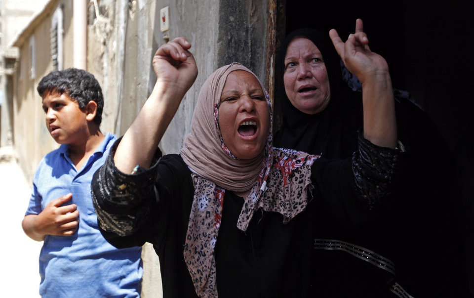 Photo - Palestinian relatives of Haitham Mishal, 29, react during his funeral in the Shati Refugee Camp in Gaza City, Tuesday, April 30, 2013. An Israeli aircraft attacked a motorcyclist in Gaza on Tuesday, killing the rider and wounding two other people in the first deadly airstrike in the Palestinian territory since a truce was reached with Palestinian militants last November. The Israeli military said the airstrike killed Haitham Mishal, whom it identified as a militant involved in the April 17 rocket attack on the southern Israeli resort town of Eilat. (AP Photo/Hatem Moussa)