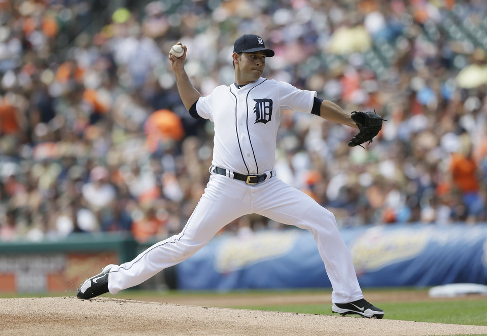 Photo - Detroit Tigers starting pitcher Anibal Sanchez throws during the first inning of an interleague baseball game against the Colorado Rockies, Sunday, Aug. 3, 2014, in Detroit. (AP Photo/Carlos Osorio)