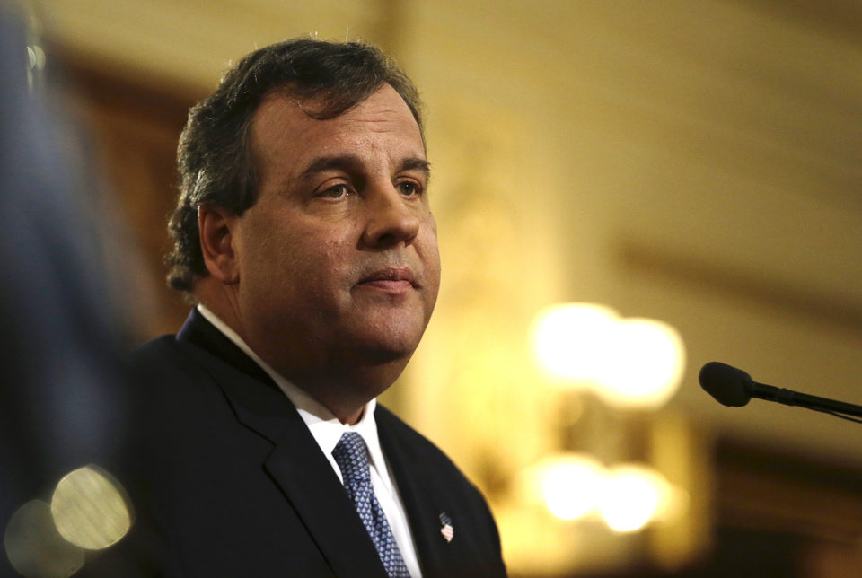 "Photo - New Jersey Gov. Chris Christie delivers his State Of The State address at the Statehouse, Tuesday, Jan. 14, 2014, in Trenton, N.J. Christie apologized again Tuesday, saying his administration ""let down the people we are entrusted to serve"" but that it doesn't define his team or the state. (AP Photo/Julio Cortez)"